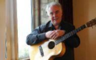 Martin Emslie with an acoustic guitar.